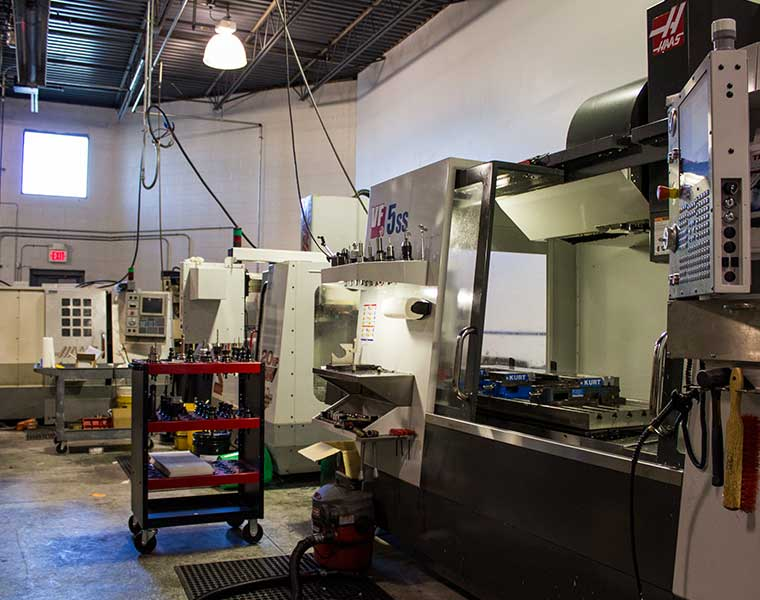 CNC machine shop with CNC lathe and multiple CNC mills
